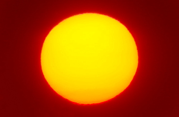Close-up of large red sun