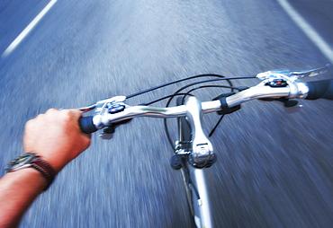 Hand gripping handlebar of bike