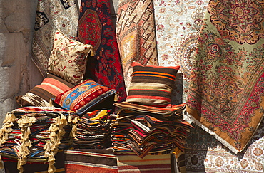 Turkey, Istanbul, Grand Bazaar, rugs and cushions for sale