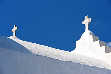 Greece, Cyclades Islands, Mykonos, Crosses on church roof