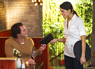 Man ordering food in restaurant