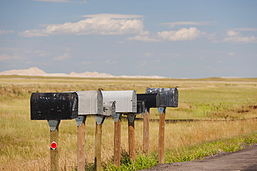 USA, South Dakota, Row of rural mailboxes on roadside in Buffalo Gap National Grasslands