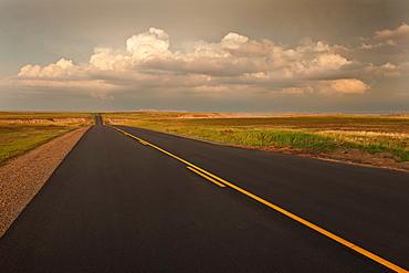 USA, South Dakota, Road in Badlands National Park at sunset