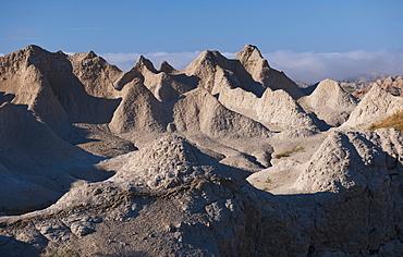 USA, South Dakota, Mountain against blue sky in Badlands National Park