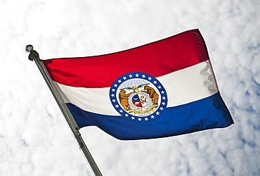 USA, Missouri State flag against sky