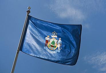 USA, Maine State flag against sky
