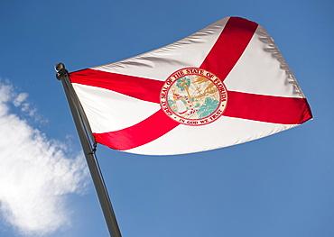 USA, Hawaii State flag against sky