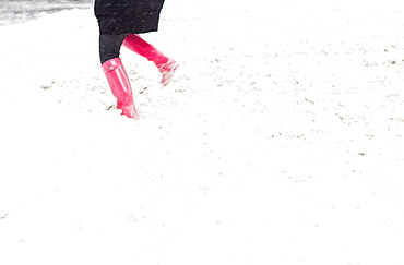 Low section of person dancing in snow, New York City, USA