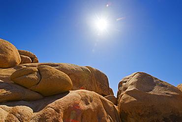 USA, California, Joshua Tree National Park, Desert rocks with solar flare, USA, California, Joshua Tree National Park