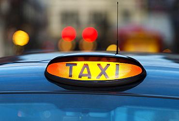UK, England, London, Sign on taxi cab, UK, England, London