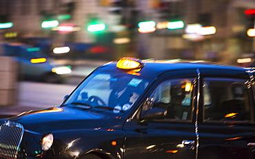 UK, London, Black cab at night, UK, London
