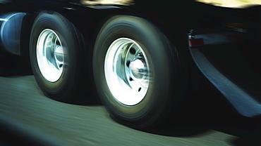 Wheels of truck in motion