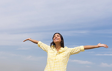 Happy woman against blue sky