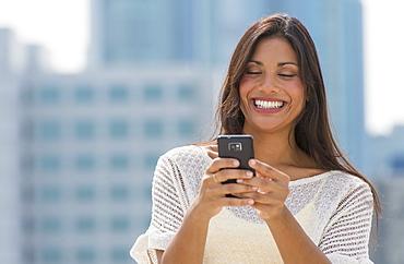 Woman text messaging, USA, New Jersey, Jersey City