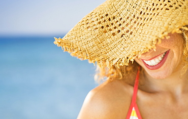 Close up of smiling woman in sun hat