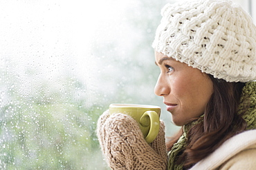 Woman in warm clothes holding mug