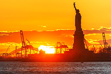 Silhouette of Statue of Liberty at sunset, New York City, New York