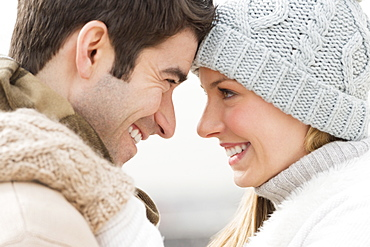 Profile of couple in winter clothing