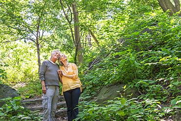 Senior couple relaxing in park, Central Park, New York City