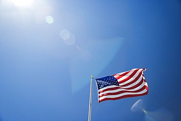 US flag against blue sky