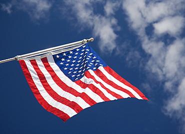 American flag under blue sky