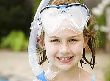 Portrait of girl in snorkeling gear