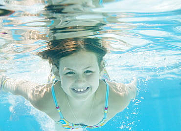 Girl swimming underwater