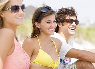 Friends in row at beach