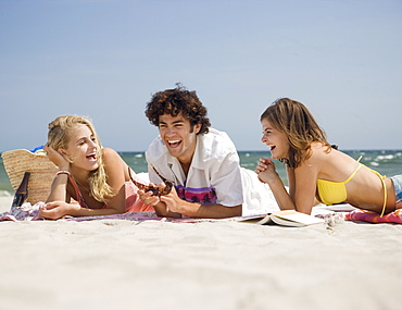 Friends laughing at beach