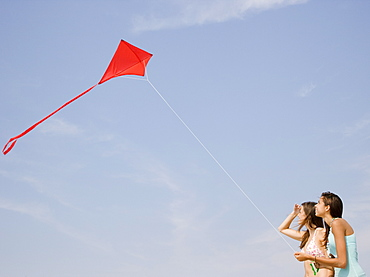 Young women flying kite
