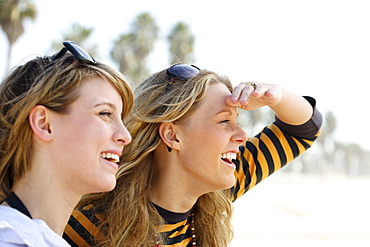 Two young women with sunglasses on head