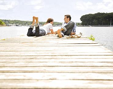 Couple laying on dock