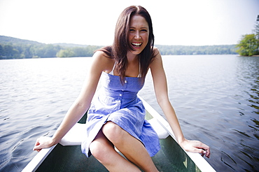 USA, New York, Putnam Valley, Roaring Brook Lake, Woman sitting in boat