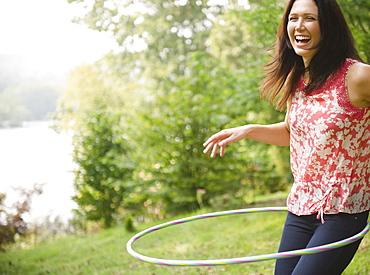 Roaring Brook Lake, Woman plying with hoopla hoop