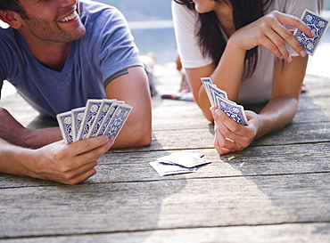 Roaring Brook Lake, Couple playing cards on pier