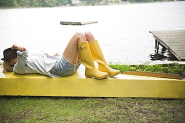 Roaring Brook Lake, Woman lying on pier by lake