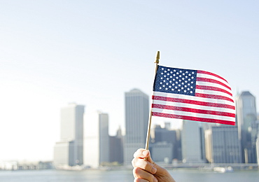 USA, New York State, New York City, Manhattan, Hand holding American flag