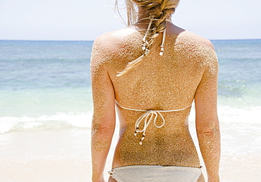 Woman's back with sticking sand, USA, Hawaii, Kauai, Princeville