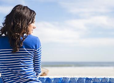 Woman relaxing on beach, Rockaway Beach, New York