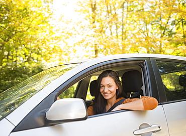 Woman driving car, Newtown, Connecticut