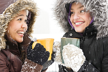 Two young women drinking hot chocolate