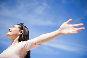 Young woman enjoying sunny weather