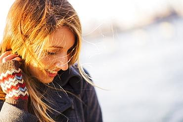 Portrait of woman in sunlight, USA, New York City, Brooklyn, Williamsburg