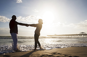 Senior couple dancing on beach, Jupiter, Florida