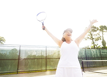 Senior woman on tennis court, Jupiter, Florida