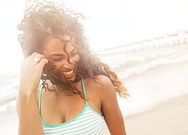 Portrait of woman standing on beach, Jupiter, Florida