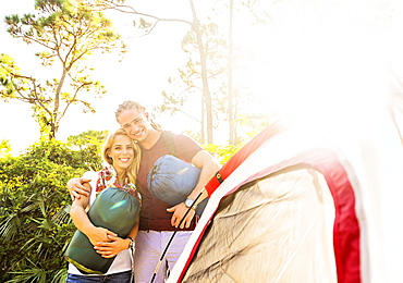 Portrait of smiling couple standing together next to tent, Tequesta, Florida