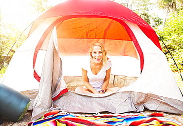 Portrait of woman sitting in tent, Tequesta, Florida