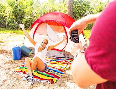 Man taking photo of woman, Tequesta, Florida