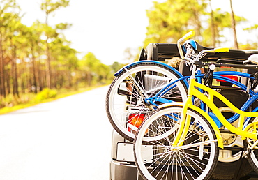 Couple in car with bike rack, Tequesta, Florida